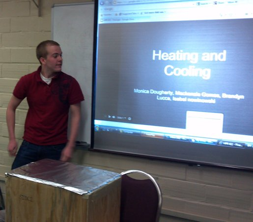 URI Honors class presenter discussing passive heating and cooling projects.